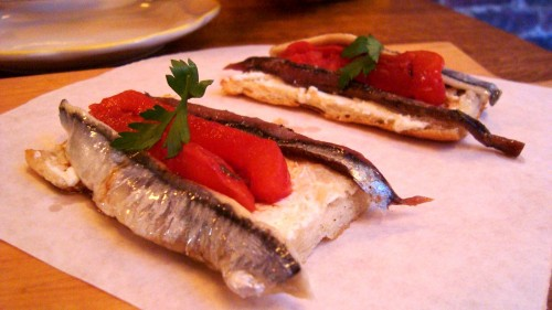 Tosta Matrimonio - black and white anchovies, slow-roasted tomato, sheep'€™s milk cheese, aged balsamic
