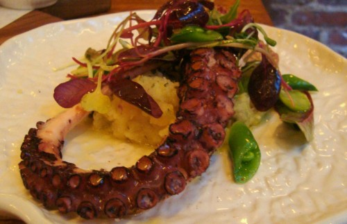 Pulpo A La Braza - Grilled octopus, fingerling potatoes, olive oil and greens.