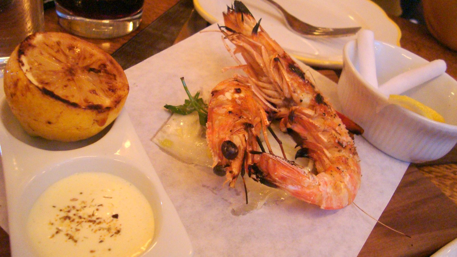 Langostino a la braza - grilled prawn, fennel, garlic yogurt sauce.