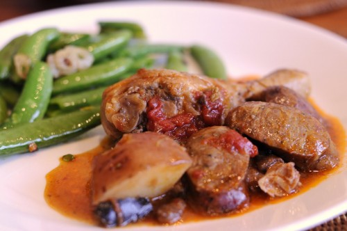 Dinner tonight: Chicken and andouille sausage stew, garlic snap peas.