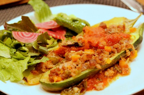 Dinner tonight: Stuffed pepper, stuffed zuchini, and a side of greens and beets.