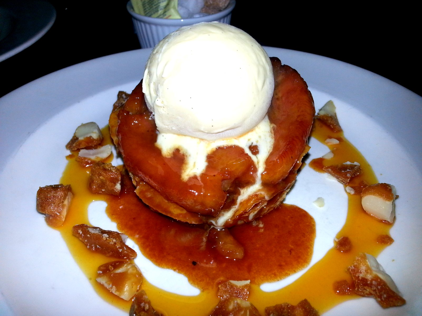 Warm Banana Tart Tatin: Passion Fruit Caramel, Vanilla Ice Cream & Macadamia Nut Brittle
