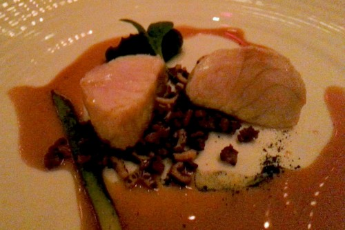Sturgeon over crispy wild rice, pureed spinach and smoked chicken jus