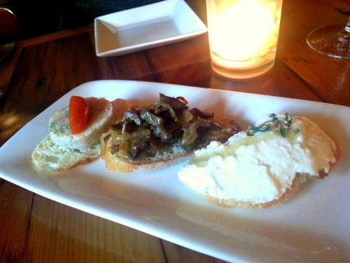 Assorted crostini: shrimp and sausage, gizzard and onion, ricotta and honey.