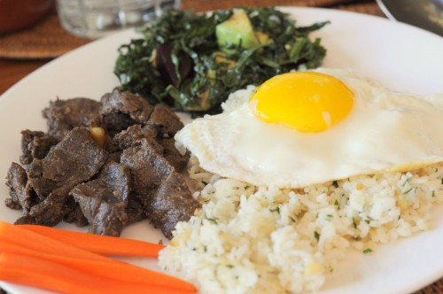 Tapsilog - a Filipino farmer's breakfast of beef, egg and garlic rice.
