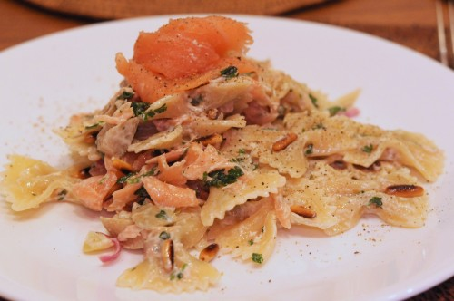 Salmon lox topped farfalle with artichokes, pine nuts and parsley in a lemon and wine cream sauce. Drool.
